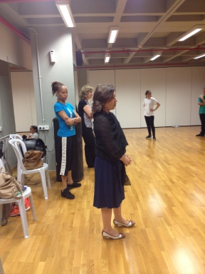 Polina Eskenazi, Cultural Program Specialist from the US Embassy, foreground, and Kellye Saunders Ballet Master of the Dance Theater of Harlem, blue t-shirt background